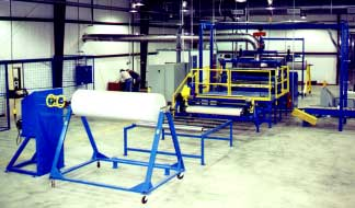 mobile rewind A-frame and drive stand winding system used on a flame laminator
